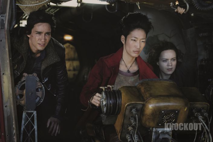 (from left) Robert Sheehan as Tom Natsworthy, Jihae as Anna Fang and Hera Hilmar as Hester Shaw in Mortal Engines. The film is directed by Christian Rivers, and written by Fran Walsh, Philippa Boyens and Peter Jackson based on the novel by Philip Reeve.
